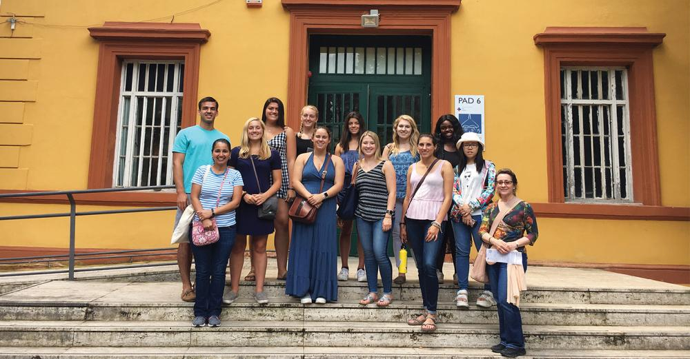 St. Lawrence professors and students taking part in the Neuroscience of Fear summer course stand outside the Museo Laboratorio della Mente (Laboratory of the Mind Museum) in Rome, Italy.