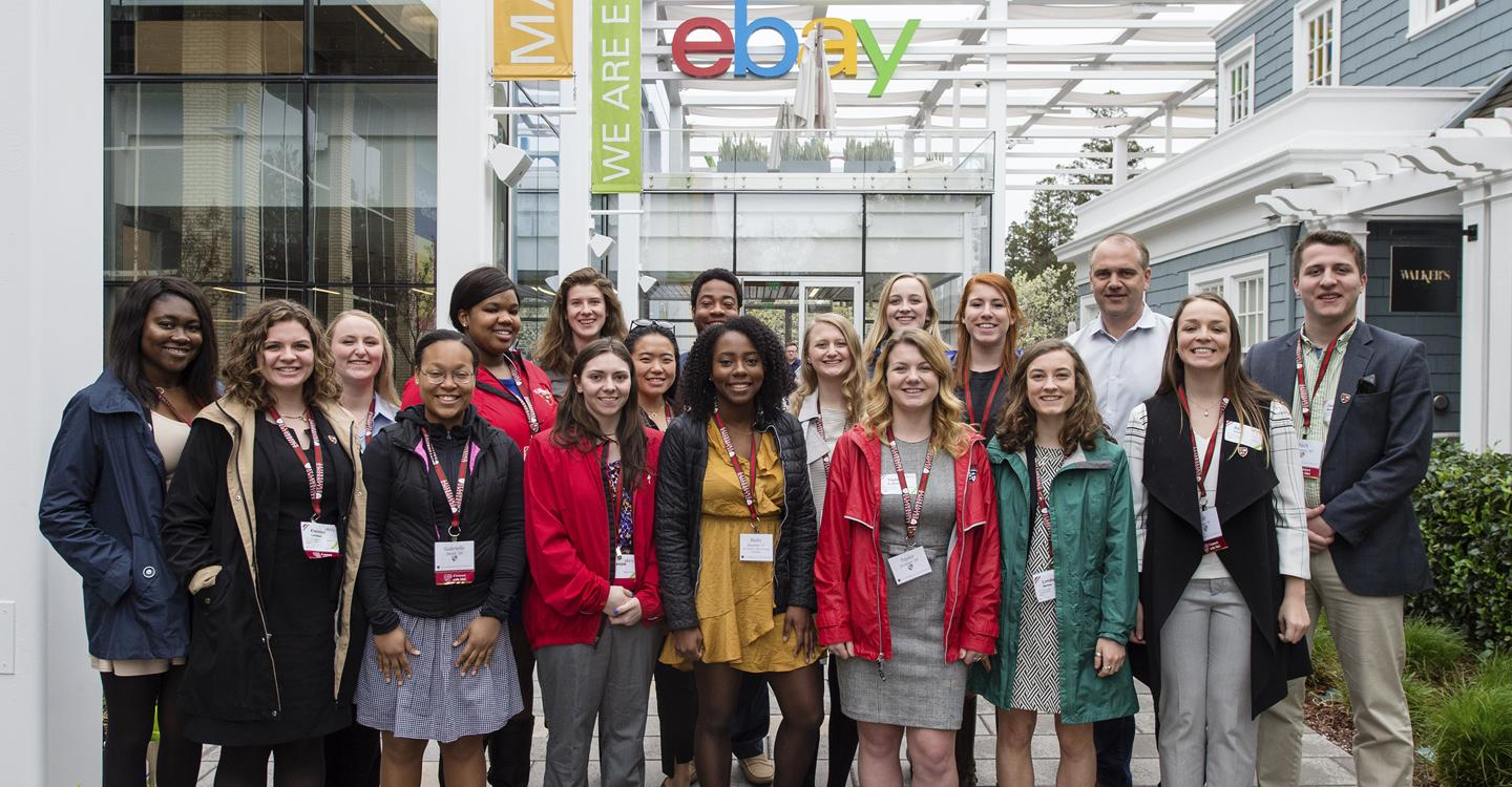 Group of students standing outside of eBay office during SLU Connect trip.